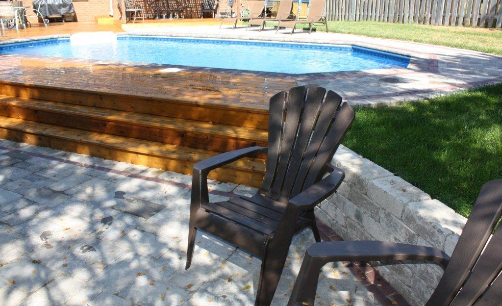 onground pool in backyard reduces need for seperate retaining wall