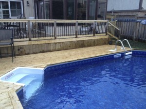 Pool with built in retaining wall